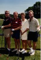 Four people golfing at the Jerilyn Britz Golf Classic.