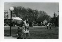 Woman and girl walking, Mankato State College, Wilson Campus School, 1976