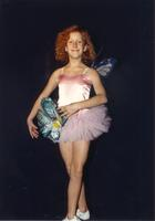 Young girl posing for picture in a dance outfit, Mankato State University, October 23, 1989.