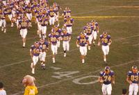 Football players running onto the field Mankato State University September 15, 1990.