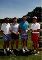 Four gentlemen golfing at the Jerilyn Britz Golf Classic.
