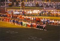 Cheerleaders lined up for the National Anthem Mankato State University September 15, 1990.