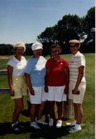 Four ladies golfing at the Jerilyn Britz Golf Classic.
