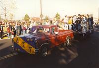 Delta Sigma Pi at the Homecoming Parade near Mankato State University, 1989-10-20.