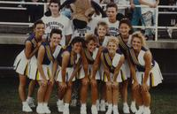 Cheerleaders taking a group picture during the Football game, MSU VS GVSU, at Blakeslee Stadium at Mankato State university, 1990-09-01.