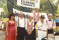 A group of KMSU staff at the Bend of the River parade, Mankato Minnesota, 1990-07-07.