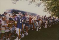 Vikings football players signing autographs for their fans at Mankato State University, 1990-08-04.