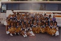 The cheerleaders are taking a group picture at the viking passing scrimmage at Mankato State University, 1990-08-04.