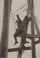 Two members of  ROTC participating in the ropes course at Mankato State University, May 12, 1990.