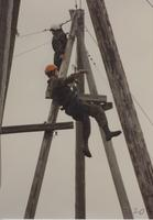 Two members of the ROTC program participating in the ropes course at Mankato State University, May 12, 1990.