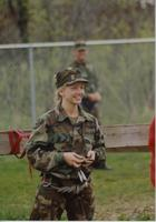 Female member of ROTC standing and smiling at the ropes course at Mankato State University, May 12, 1990.