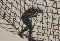 Male member of ROTC participating in the ropes course at Mankato State University, May 12, 1990.