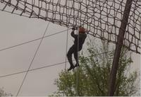 Member of ROTC participating in the ropes course located at Mankato State University, May 12, 1990.