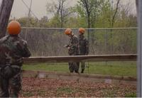 Three member of ROTC participating in the ropes course located at Mankato State University, May 12, 1990.