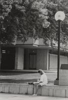 The unknown female student is studying at the Campus Mall at Mankato State University, 1980's.