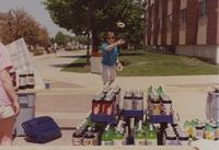 MSU student participates in ring toss game located on the Campus Mall at Mankato State University, 1991-05-15.