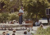 Students surround a man performing at the Campus Mall, Mankato State University, 1991-05.