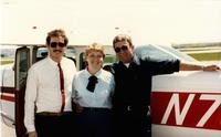 Michelle Strenge and two other gentlemen in front of aircraft, Mankato State University.