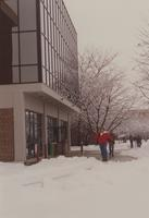 Students are walking toward the Memorial Library at Mankato State University, 1992-02-18