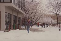 Students are walking outside of Memorial Library at Mankato State University, 1992-02-18