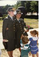 Two officers and two children at ROTC ceremony; Mankato State University