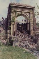The arch at Old Main before removal and reconstruction as the Alumni Arch. Mankato State University, 1990s.
