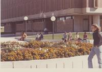 Students seated on ledge outside Armstrong Hall, Mankato State College