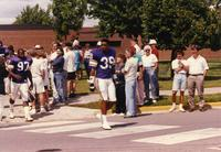 Minnesota Vikings players Carl Lee (39) and Henry Thomas (97) walking to the practice field at Mankato State University
