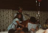 School of Nursing Pinning Ceremony at the Holiday Inn, Mankato, 1990-92. Pictured L-R: Lindy Olsen, Scott Fiegel, and seated: Mary Peterson, Nancy McLoone.