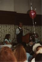 Scott Fiegel speaking at the School of Nursing Pinning Ceremony at the Holiday Inn, Mankato, 1990-92. Pictured L-R: Lindy Olsen, Scott Fiegel, Mary Peterson.