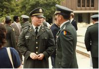 Members of the Mankato State University ROTC program talking during an event outside the Centennial Student Union, 1980s.
