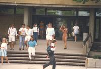 Mankato State University students enter and exit Armstrong Hall at Mankato State University, 1989-05-23.