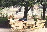 A female student studies outside on the Campus Mall near the Fountain at Mankato State University, 1989-05-23.