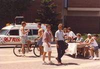 Delta Tau Delta Fraternity tables at Mankato State University Campus Mall for a fundraiser as others walk by, 1991-05-15.