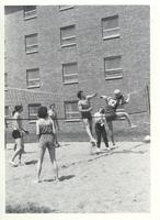 Students versus one another in a game of volleyball at the McElroy Residence Community at Mankato State University.