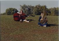 Charlotte Meemken and David Grimmer (band students) play their instruments on a hill near Mankato State University, 1989-09-27.
