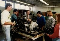 Professor teaching students about a machine in Engineering class at Mankato State University
