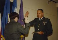 Unidentified woman swears in to protect her country Mankato State University June 7, 1991.