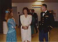 Unidentified people talking at ROTC graduation April 12, 1991.
