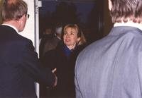 A man reaches out his hand to greet Hillary Clinton at Mankato State University, 1992-10.
