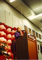 Hillary Clinton speaks behind a podium at the Clinton-Gore campaign in Otto Arena at Mankato State University, 1992-10.