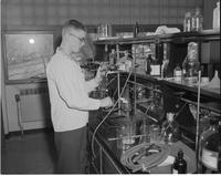 Chemistry Student in Chemistry Lab, Mankato State College, 1958-03-21.