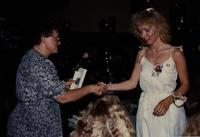 School of Nursing Pinning Ceremony at the Holiday Inn, Mankato, 1990-92. Pictured L-R: Dr. Kathryn Schweer, Dean of School of Nursing.