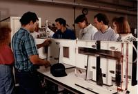 Students working together on a machine during an Engineering class at Mankato State University