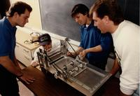 Students working on a machine during an Engineering class at Mankato State University