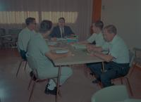 A discussing group in a conference room, Mankato State College, 1966-09-01