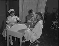 Student Nursing and Doctor doing checkup at Mankato State College on September 21, 1959.