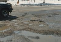 A picture of potholes in Stadium Road near Mankato State University, 1989.