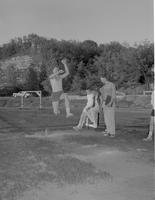 A practicing male athlete in long jump, Mankato State College, 1958-06-30