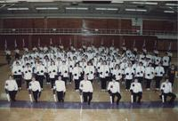 Members of the Mankato State University band posing for a picture in Otto Recreation Center, 1980s.